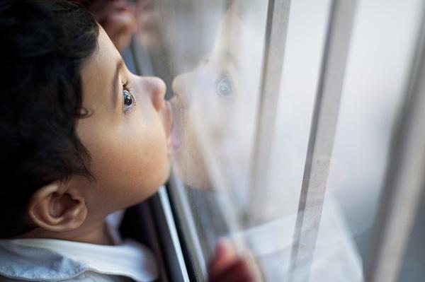 Hidden-Dangers-Child-Looking-Out-Window