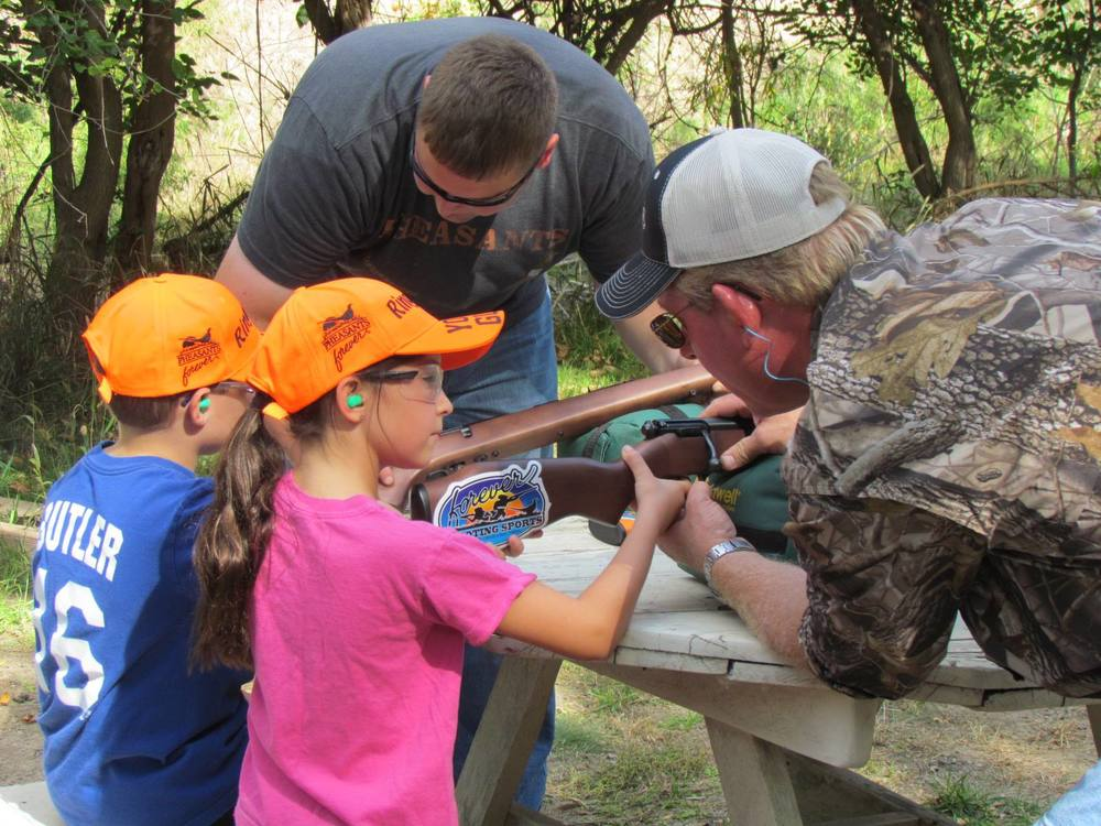 kids learning how to use a gun safely